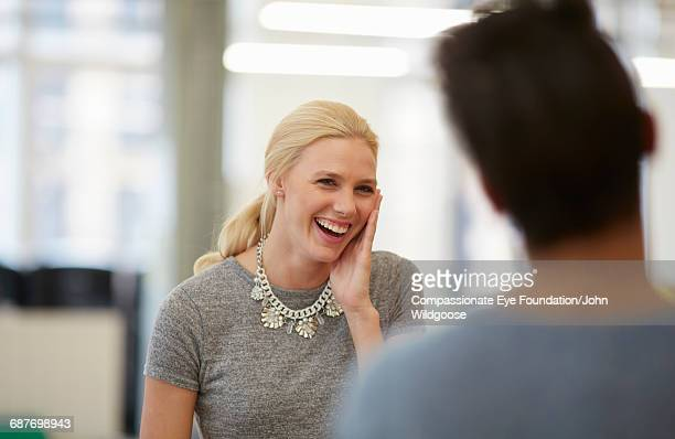 Happy businesswoman laughing in office