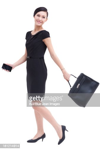 Happy businesswoman on the move