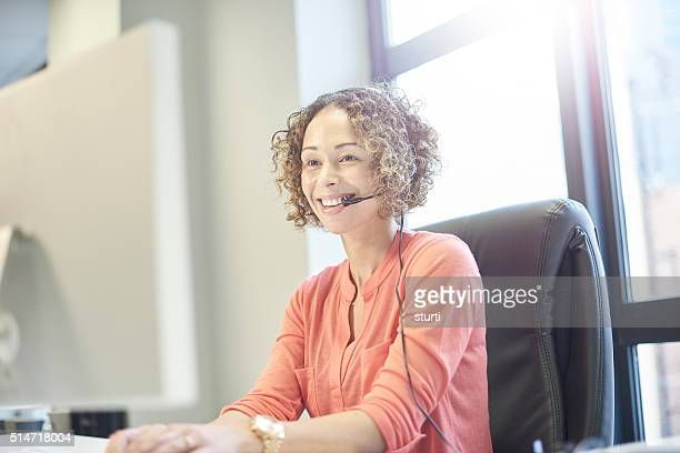 happy businesswoman on the phone