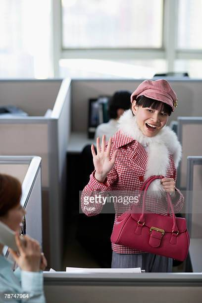 Happy Businesswoman Waving Goodbye