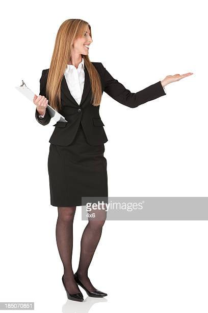 Happy businesswoman with a clipboard