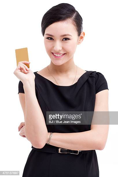 Happy businesswoman with bank card