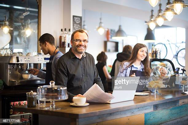 happy cafe owner doing his paperwork
