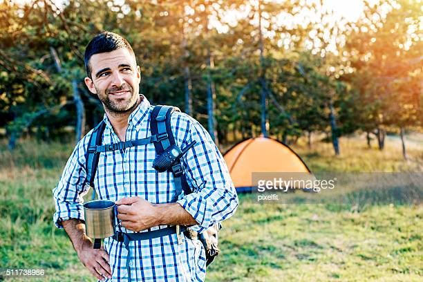 Happy camper outdoors in the forest