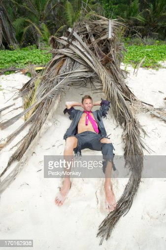 Happy Castaway Businessman Relaxes in Shelter