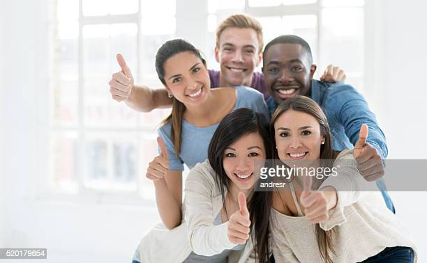 Happy casual group with thumbs up