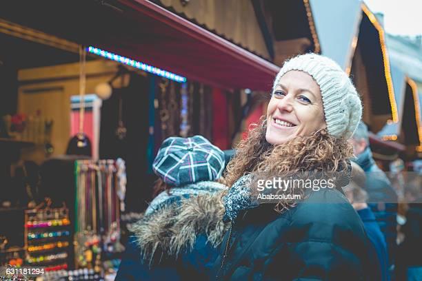 Happy Caucasian Women Shopping at Christmas Market, Carinthia, Austria