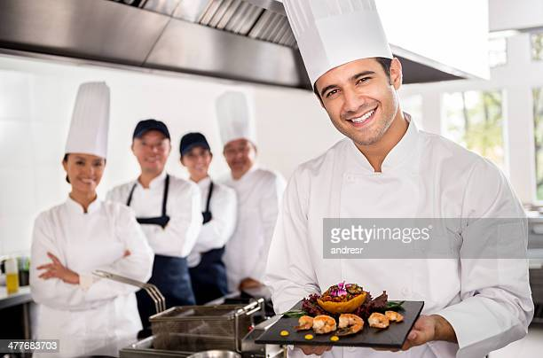 Happy chef introducing a dish