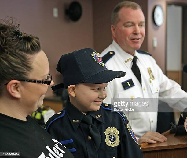 A happy Chief for a Day Tyler Seddon a Rhode Island boy bravely battling leukemia who wanted birthday cards from police officers and firefighters for...