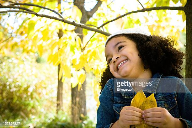 Happy Child Holding Leaves
