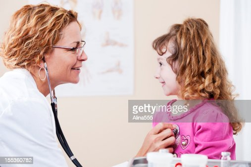 Happy child patient during doctor's visit : Stock Photo