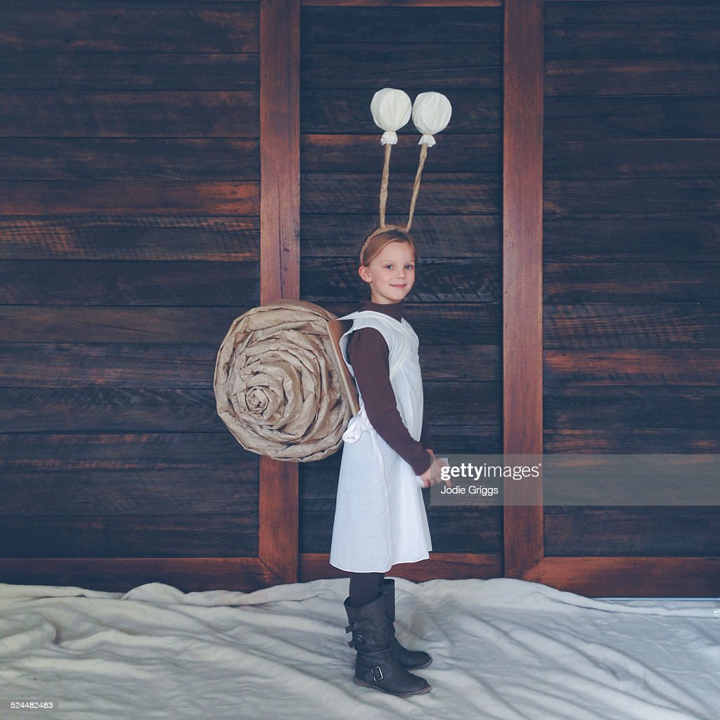 Happy child wearing home-made snail costume