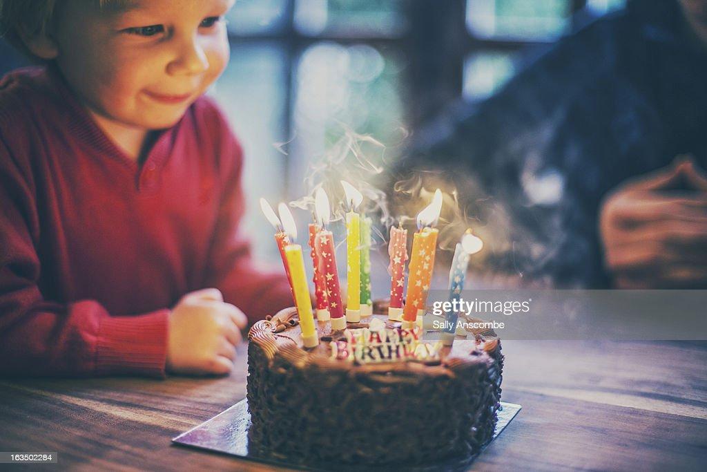 Happy child with a birthday cake : Stock Photo