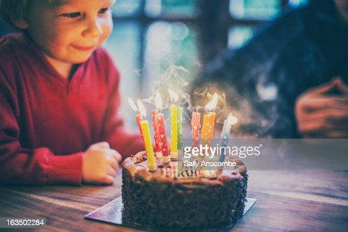 Happy child with a birthday cake : Stock Photo