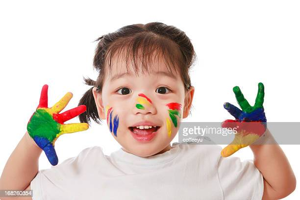 Happy child with colorful hands