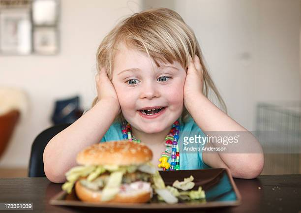 Happy child with hamburger