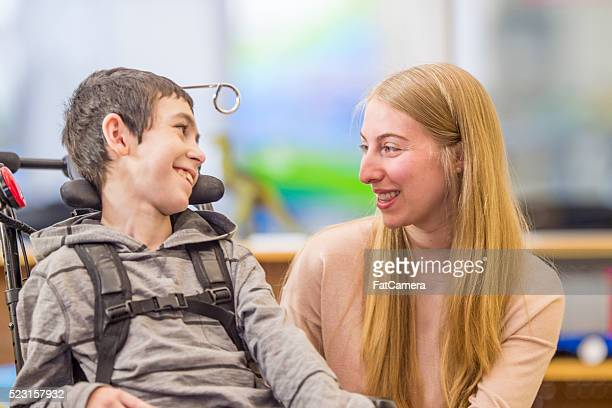 Happy Child with His Caregiver