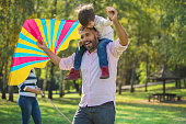Happy father and son have a fun in public park