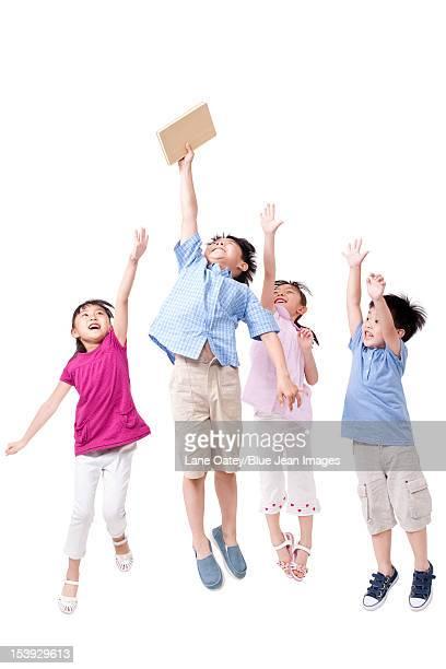 Happy children and book