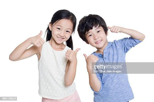 Happy children doing thumbs up