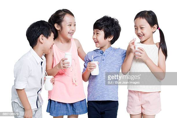 Happy children drinking yogurt