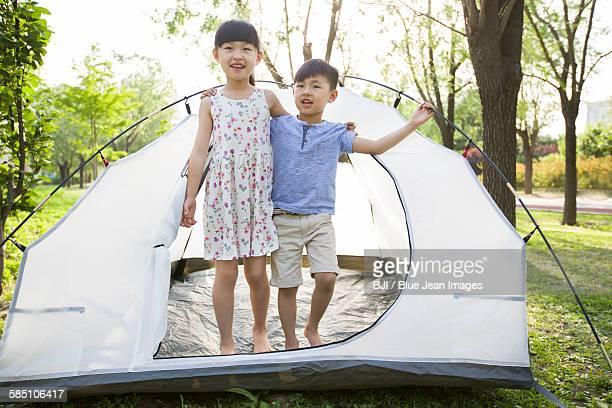 Happy children enjoying a camping trip