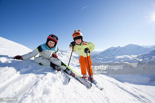 happy children in skiing outfit