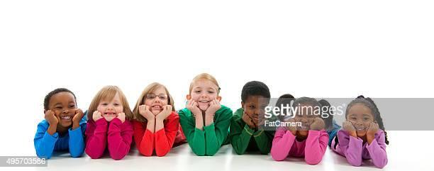 Happy Children Lying in a Row