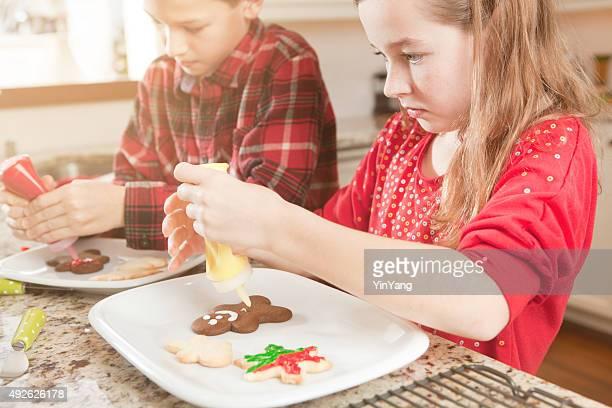 Happy Children Making Christmas Cookies in Kitchen