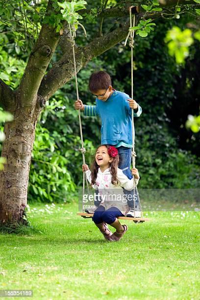 Happy children on a swing