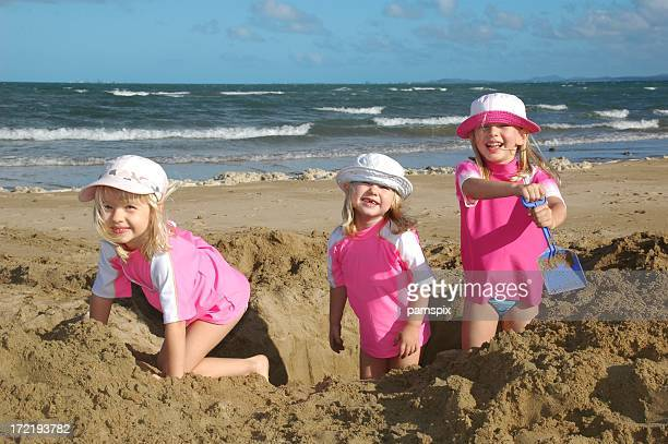 Happy children playing at the beach