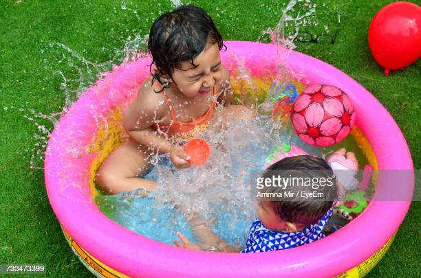Happy Children Playing In Swimming Pool