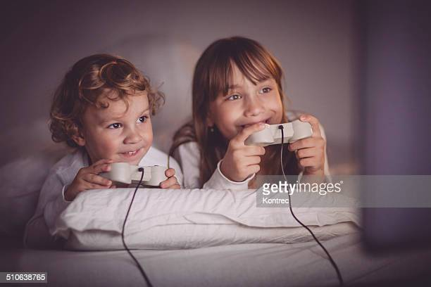 Happy children playing video games