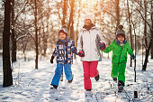 Happy children running in beautiful winter forest