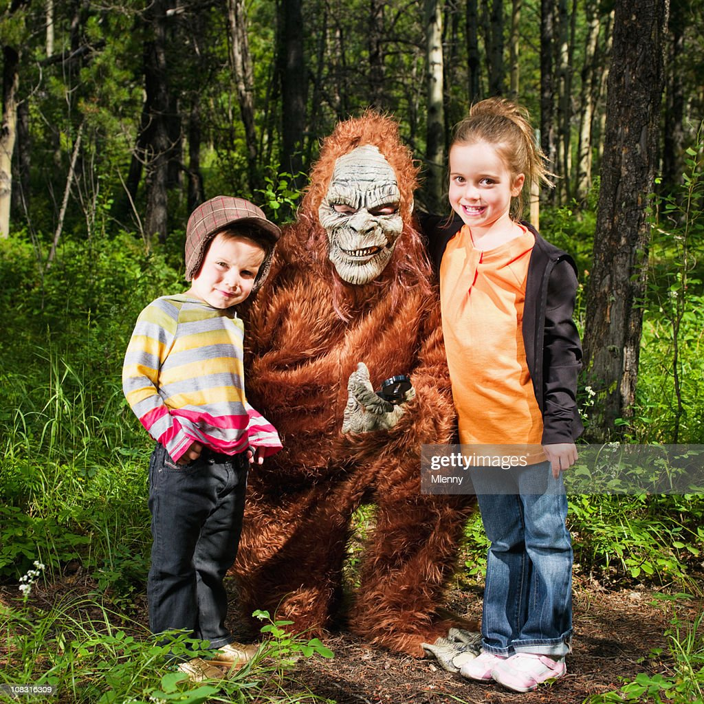 Happy Children together with Sasquatch in the Woods