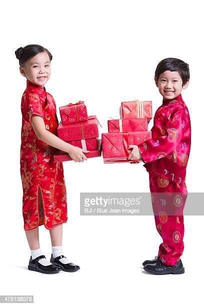 Happy children with presents celebrating Chinese New Year