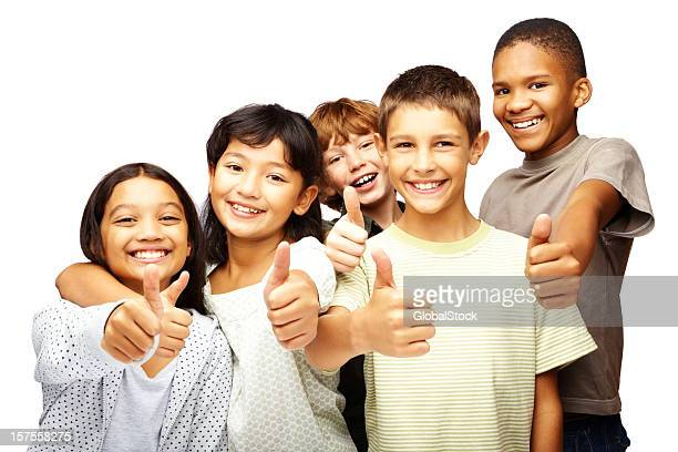 Happy children with thumbs up over white