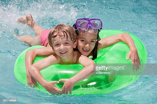 Happy Childrenin Swimming Pool