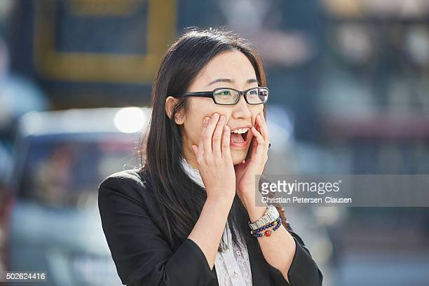 Happy Chinese businesswoman acting surprised