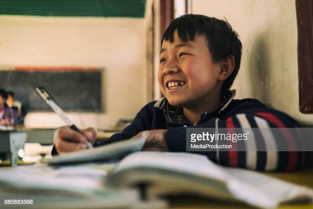 Happy Chinese school child  in classroom