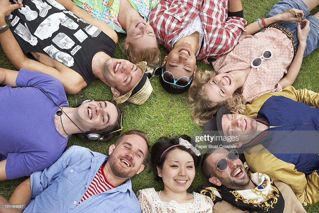 A happy circle of friends in the park : Stock Photo
