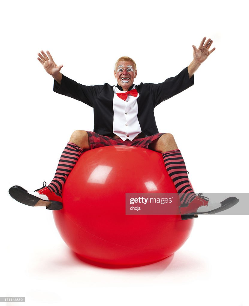 Happy clown on red ball