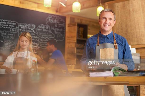 Happy coffee shop owner