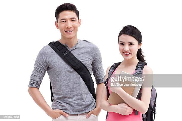 Happy college couple with books