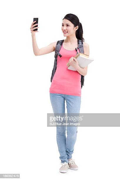 Happy college girl with smart phone