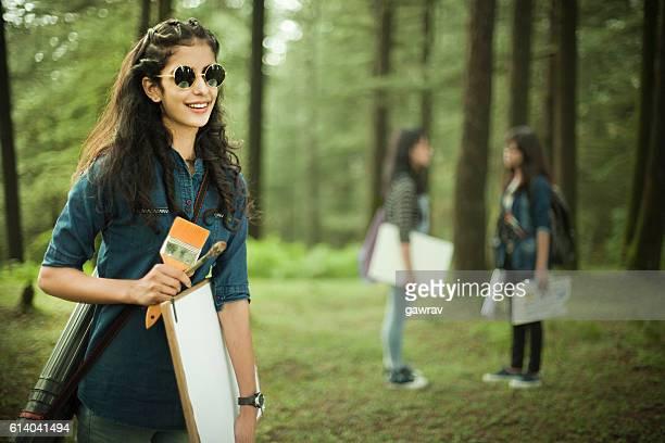 Happy, confident, female fine art college students in outdoor location.