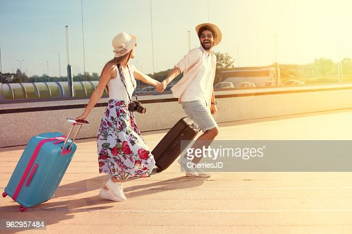 Happy couple arrived at the holiday destination : Stock Photo