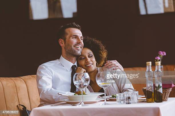 Happy couple at dinner in the restaurant