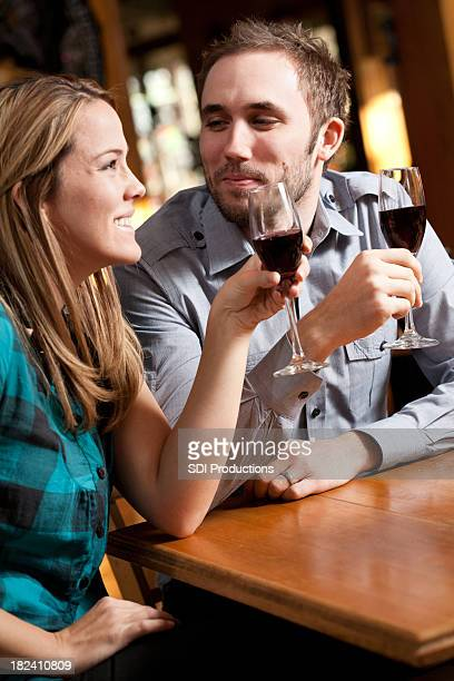 Happy Couple at Restaurant Drinking Champaign