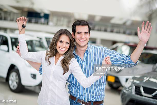 Happy couple buying a car